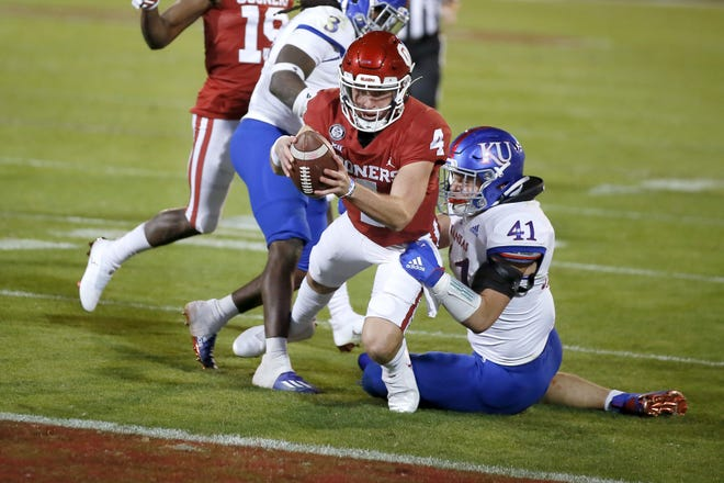 Oklahoma's Chandler Morris (4) dives for a touchdown beside Kansas' Nick Channel (41) during a college football game between Oklahoma and Kansas in Norman. Morris announced on Sunday he will be transferring to TCU. [Bryan Terry/The Oklahoman]
