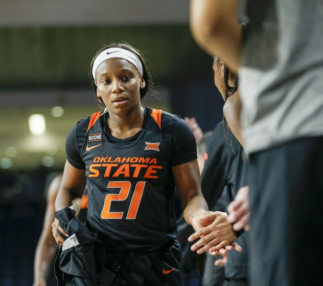 Oklahoma State guard Ja'Mee Asberry (21) high fives teammates during a recent game against Tulsa. Asberry scored a game-high 28 points Saturday to help the Cowgirls beat Texas Tech and stay undefeated in Big 12 play. [IAN MAULE/Tulsa World]