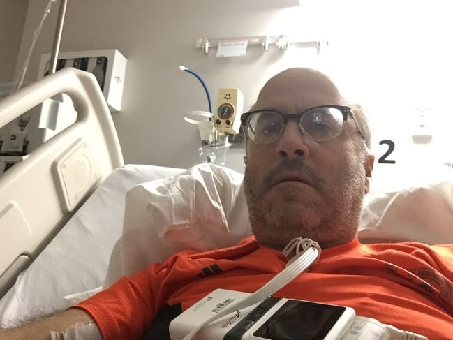 Jeff Greenlee, of Altus, was hospitalized with COVID-19 for a week in November. An endurance athlete, Greenlee donned a Boston Marathon shirt to provide motivation for his first walk after being confined to a hospital bed for several days. [OMRF]