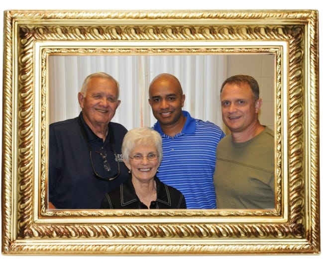 Legendary high school basketball coach Dub Raper, left, won hundreds of games during his four-decade-long career. But his proudest accomplishment was when men who he coached became coaches. Among them was Lenny Hatchett, middle, pictured with Raper's wife, Jackie, and middle son, Scott. Raper considered his players as part of his family. [PHOTO PROVIDED]