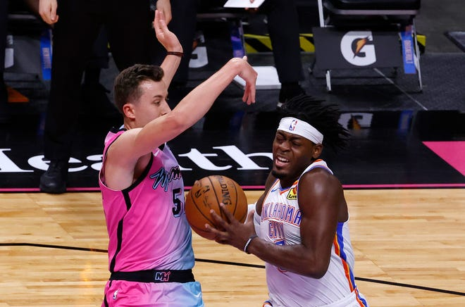 Jan 4, 2021; Miami, Florida, USA; Miami Heat forward Duncan Robinson (55) defends Oklahoma City Thunder guard Luguentz Dort (5) during the first half at American Airlines Arena. Mandatory Credit: Rhona Wise-USA TODAY Sports
