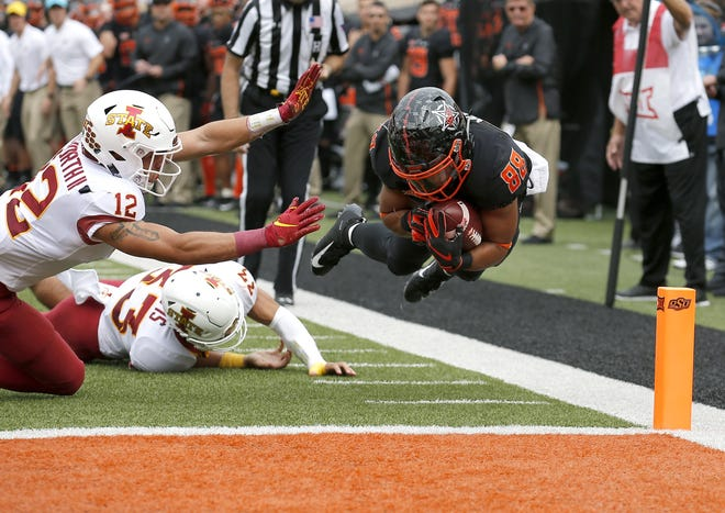 Oklahoma State's Landon Wolf (88) dives in for a touchdown as Iowa State's Greg Eisworth (12) and Braxton Lewis (33) defend in the second quarter between the Cowboys and Cyclones. Wolf announced on Twitter on Monday his decision to leave as a graduate transfer. [Sarah Phipps, The Oklahoman]