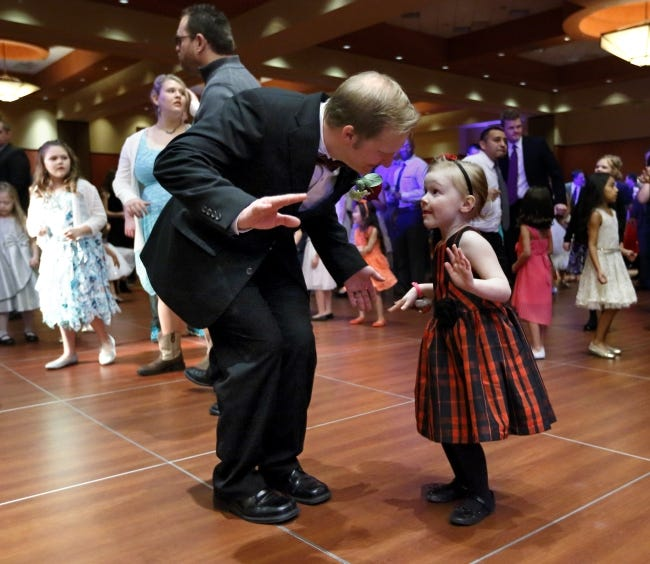 Jason Christopher and daughter Adeline dance at the Norman Daddy Daughter Dance during a previous year's event. This year's Daddy Daughter Dance has been canceled due to health concerns amid the COVID-19 pandemic. [THE OKLAHOMAN ARCHIVES]