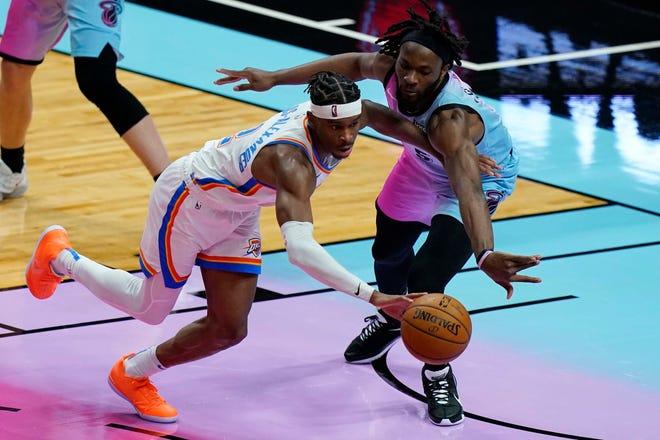 Miami Heat forward Precious Achiuwa (5) defends Oklahoma City Thunder guard Shai Gilgeous-Alexander (2) during the second half of an NBA basketball game, Monday, Jan. 4, 2021, in Miami. (AP Photo/Marta Lavandier)