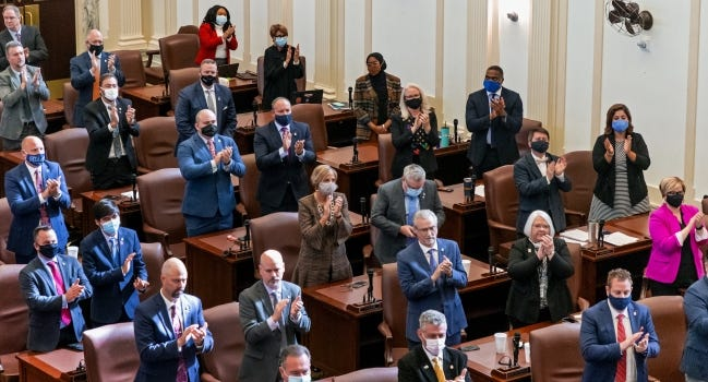 Members of the House of Representatives stand and applaud Speaker of the House Charles McCall who was reelected to his leadership role Tuesday at the state Capitol in Oklahoma City. [Chris Landsberger/The Oklahoman]