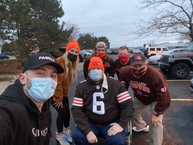 Cleveland Browns quarterback Baker Mayfield and his wife, Emily Mayfield, with Tom Seipel (seated) Rawley Davis, Kevin Tuleta and Tom Seipel Sr. after the Browns' win over the Pittsburgh Steelers Sunday. Seipel, a life-long Browns fan who is in hospice, was invited to watch the game in Emily Mayfield's suite. [PHOTO PROVIDED]
