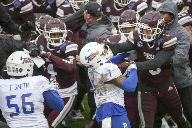 Mississippi State linebacker Aaron Brule (3) hits Tulsa safety TieNeal Martin (7) on the facemask during a postgame fight after the Bulldogs' win in the Armed Forces Bowl on Dec. 31 in Fort Worth, Texas. [Ian Maule/Tulsa World]