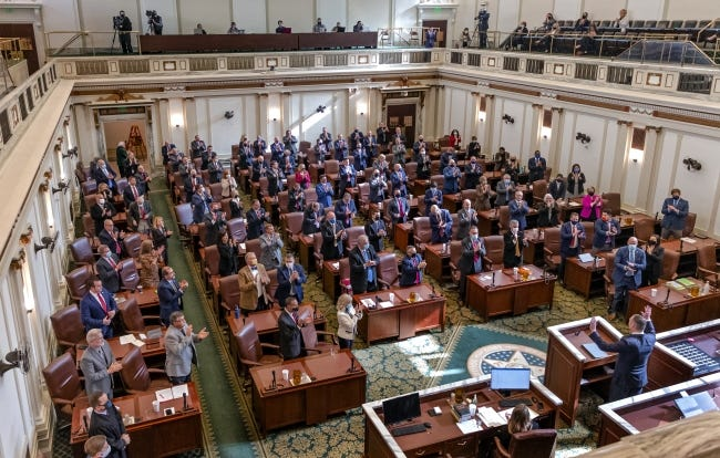 Members of the House of Representatives stand and applaud Speaker of the House Charles McCall at the state Capitol in Oklahoma City on Jan. 5. The House passed two bills expanding school transfer opportunities for students and limiting the resulting financial overlap. [Chris Landsberger/The Oklahoman]