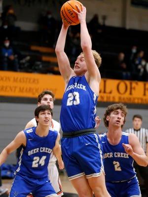 Deer Creek's Camden Laskie grabs a rebound during a high school boys basketball game between Norman and Deer Creek in Norman, Okla. Tuesday, Jan. 5, 2021. [Bryan Terry/The Oklahoman]