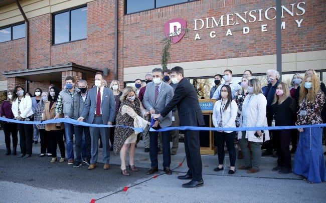 Officials cut a ribbon for the for Norman Public Schools' Dimensions Academy building that houses the district's alternative education program in Norman, Okla., Tuesday, Jan. 5, 2021. [Sarah Phipps/The Oklahoman]