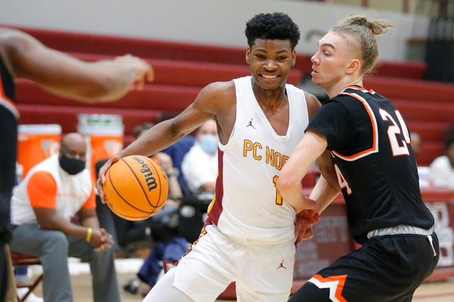 Putnam City North's Josh Nwankwo tries to get past David Orvis during a high school boys basketball game in the Putnam City Invitational tournament at Putnam City North in Oklahoma City, Thursday, Jan. 7, 2021. He scored 18 points in the area final to beat Edmond North. [Bryan Terry/The Oklahoman]