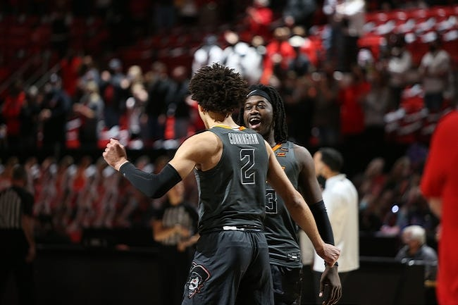 OSU guard Isaac Likekele, back, reacts with guard Cade Cunningham against Texas Tech earlier this season. [Michael C. Johnson/USA TODAY Sports]