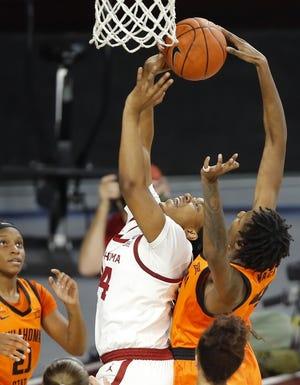 Oklahoma State's Natasha Mack (4) recorded the program's second-ever triple-double last week against TCU. [Bryan Terry/The Oklahoman]