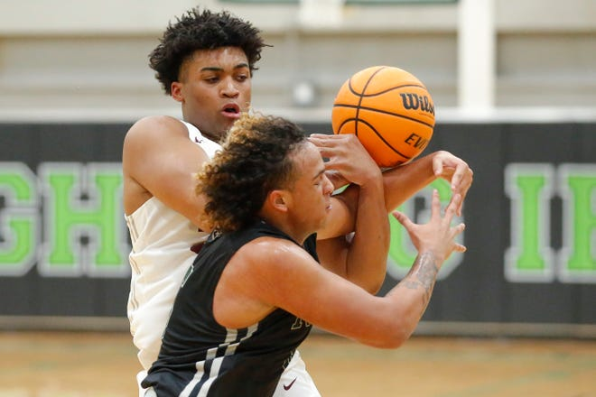 Norman North's Aiden Walker takes the ball away from Edmond Memorial's Carter Hjelmstad during a basketball game between Del City and Choctaw in the McGuinness Classic in Oklahoma City, Friday, Jan. 8, 2021. [Bryan Terry/The Oklahoman]