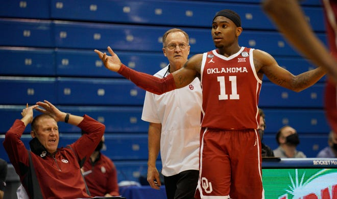 Jan 9, 2021; Lawrence, Kansas, USA; Oklahoma Sooners guard De'Vion Harmon (11) and head coach Lon Kruger react to a penalty call during the first half against the Kansas Jayhawks at Allen Fieldhouse. Mandatory Credit: Denny Medley-USA TODAY Sports