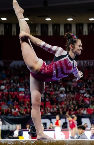 OU's Carly Woodard competes in the beam during a women's gymnastics competition against Arkansas on Jan. 20 last year in Norman. [Chris Landsberger/The Oklahoman]