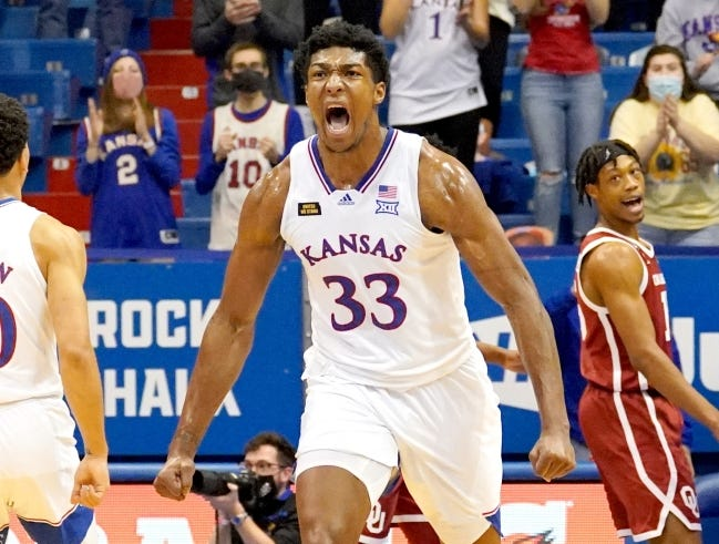 Kansas forward David McCormack (33) celebrates after scoring against Oklahoma during the second half of a 63-59 win Saturday in Lawrence, Kan. [Denny Medley/USA TODAY Sports]