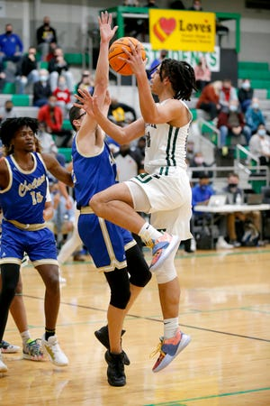 Norman North's Kayden Carter goes up for a basket as Choctaw's Sean Franklin defends during the high school boys game between Norman North and Choctaw at Bishop McGuinness High School in Oklahoma City, Saturday, Jan. 9, 2021. [Sarah Phipps/The Oklahoman]