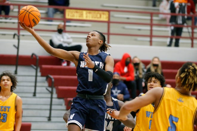 Edmond North's Joell Wilson goes to the basket during the championship game in the Putnam City Invitational tournament between Edmond North and Putnam City West at Putnam City North in Oklahoma City, Saturday, Jan. 9, 2021. [Bryan Terry/The Oklahoman]