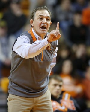 Oklahoma State coach John Smith gives instructions to a wrestler during a match. Sunday, he watched his Cowboys beat Chattanooga and Oregon State in Stillwater. [Bryan Terry/The Oklahoman]