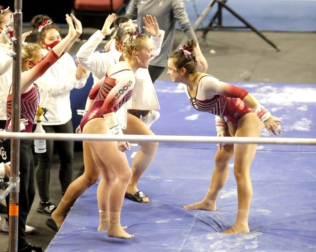 OU's Karrie Thomas celebrates after the uneven bars during Sunday's gymnastics meet against Arizona State at Lloyd Noble Center in Norman. [Sarah Phipps/The Oklahoman]