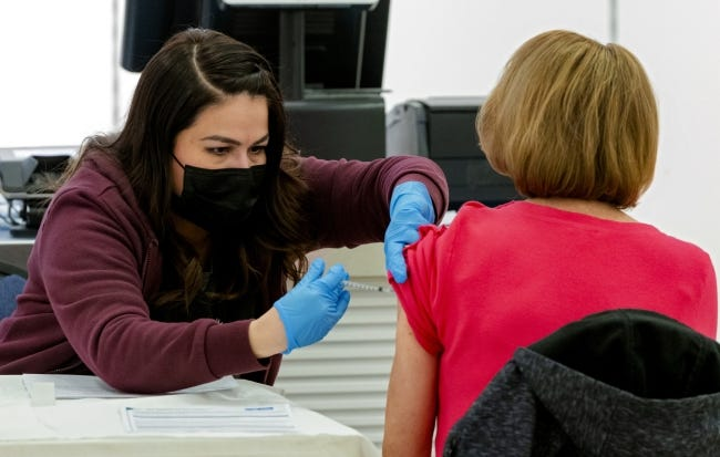 A nurse administers an injection of the COVID-19 vaccine on a client in the Cleveland County Health Department's vaccine pod at Sooner Fashion Mall in Norman on Jan. 7. [Chris Landsberger/The Oklahoman]