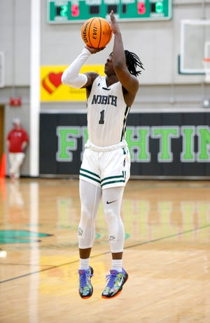 Norman North's Jaylon White shoot a basket during the high school boys game between Norman North and Choctaw at Bishop McGuinness High School in Oklahoma City, Saturday, Jan. 9, 2021. He had a stellar performance in Saturday's win against Midwest City. [Sarah Phipps/The Oklahoman]