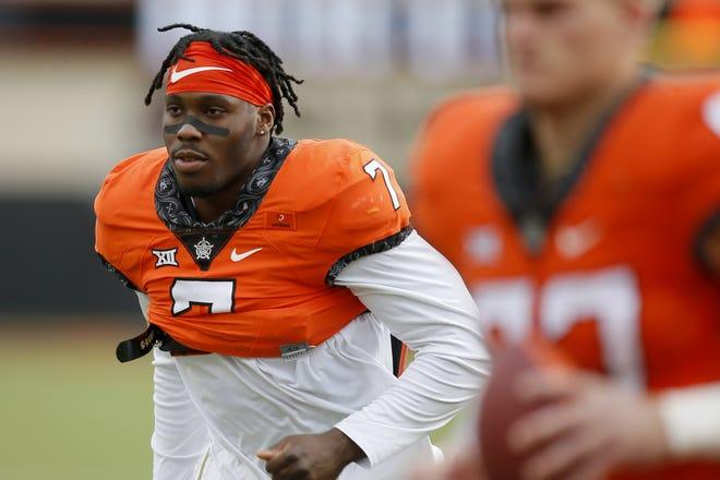 Oklahoma State Cowboys linebacker Amen Ogbongbemiga has declared for the NFL Draft. [Bryan Terry/The Oklahoman]