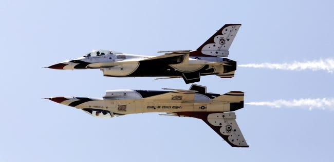 Tinker Air Force Base has canceled its 2021 air show that was scheduled for June. The main attraction would have been a demonstration from the U.S. Air Force Thunderbird, which last flew over Oklahoma in 2017. In this photo from that show, pilots maneuver their F-16 aircraft within feet of each other while one is flying inverted. [THE OKLAHOMAN ARCHIVES]