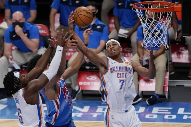Thunder forward Darius Bazley (7) strips the ball from Nets center Jarrett Allen (31) with Luguentz Dort (5) defending during the first half of Oklahoma City's 129-116 win Sunday. [AP Photo/Kathy Willens]