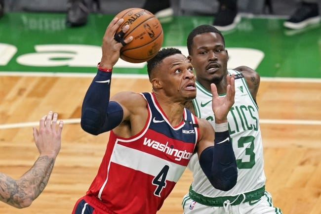 Washington Wizards guard Russell Westbrook (4) drives against Boston Celtics guard Javonte Green during the first quarter of a game on Friday, Jan. 8, 2021, in Boston. [AP Photo/Elise Amendola]