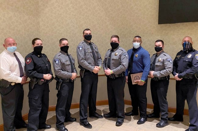 Pictured from left to right are Jerry McConnell, Moore Norman Technology Center's director of campus safety and security; Sarah Sladek; Wesley Ivy; Benjamin Hoffman; Stephen Flanagan; Demetrius Smith; Joshua Winkle; and Sgt. Robert Wasoski, MNTC Basic Peace Officer Academy instructor. [PHOTO PROVIDED]