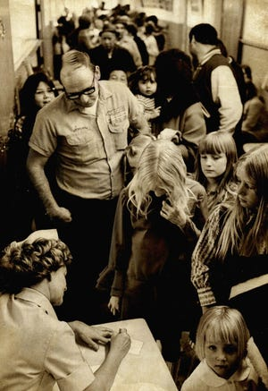 Locust Grove residents line up to be vaccinated against an infectious hepatitis outbreak in 1971. Red Cross nurse Peggy Madole monitored the line of people waiting to receive their shots. Schools had been closed as officials worked to guard against the disease that some were blaming on the town's outdated water supply system. Each day, shots were given until the vaccine serum was gone. Vaccines received by those pictured were made possible after a new supply arrived from St. Louis. [JOE AKER/THE OKLAHOMAN ARCHIVES]