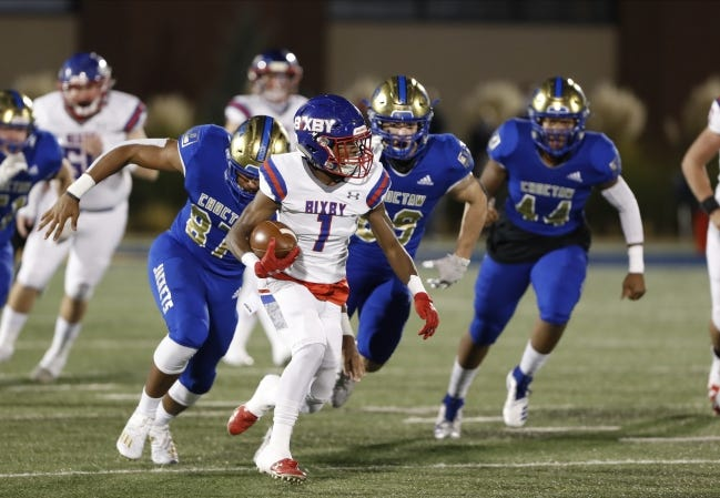 Bixby´s Braylin Presley (1) runs ahead of Choctaw defenders for a first down during the Class 6A-II title game at Wantland Stadium in Edmond on Dec. 5. [Alonzo J. Adams/for The Oklahoman]