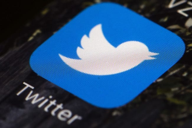 FILE - This April 26, 2017, file photo shows the Twitter app icon on a mobile phone in Philadelphia. A conservative social media user whose memes have been repeatedly reposted by President Donald Trump has been kicked off Twitter for repeated copyright violations. Logan Cook, who posts under the name Carpe Donktum, was permanently suspended Tuesday, June 23, 2020. The move came days after Trump retweeted a Cook video that contained doctored CNN footage. (AP Photo/Matt Rourke, File)