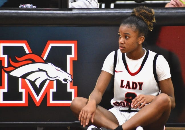 Mustang guard Randi Harding waits to enter the game against Southmoore on Tuesday. [JAMES D. JACKSON/THE OKLAHOMAN]