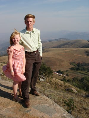 Barry Schmelzenbach and his daughter, Vien, are shown in Endingeni, Swaziland (currently Eswatini), where his great-grandfather, Haroman F. Schmelzenbach, began his missionary work and the family legacy more than 100 years ago. [Photo provided]