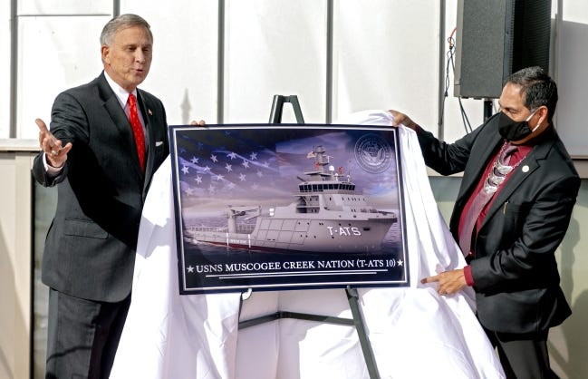 Acting Under Secretary of the Navy, Gregory J. Slavonic and Muscogee (Creek Nation) Chief David Hill, from left, unveil the naming of the naval ship USNS Muscogee Creek Nation during a Navy press conference Friday at the First Americans Museum in Oklahoma City. [Chris Landsberger/The Oklahoman]