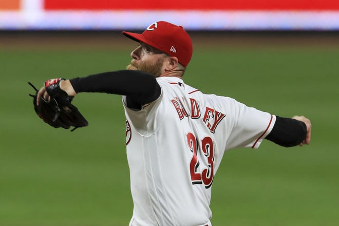 In this Sept. 14, 2020, photo, Cincinnati Reds' Archie Bradley throws against the Pittsburgh Pirates in Cincinnati. The Philadelphia Phillies and Bradley have agreed on a $6 million, one-year contract. [AP Photo/Aaron Doster]