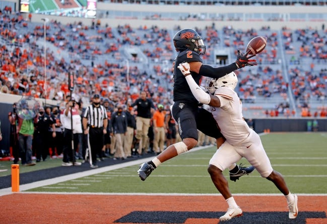 Receiver Tylan Wallace (2) appears likely to be the first Oklahoma State player taken in April's NFL Draft. [SARAH PHIPPS/THE OKLAHOMAN]