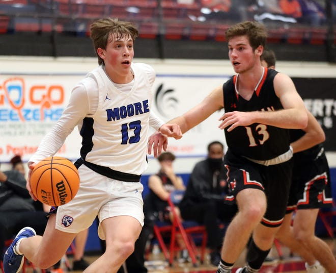 Moore's Dylan McDougal scored 19 points to help the Lions top district rival Westmoore in the Class 6A regional at Edmond Memorial. [Steve Sisney/For The Oklahoman]