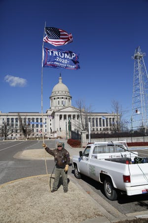 Self-proclaimed patriot, Rob Hooper, shows his support of Trump on Sunday and is prepared to talk politics with anyone who wants an honest discussion.