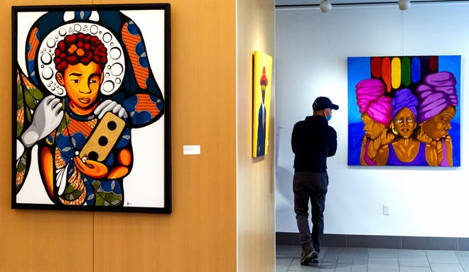 """A visitor views the art on display in the """"Still Here: The Cosmology of Black Resilience"""" exhibit during the Martin Luther King Jr. Observation at the Myriad Botanical Gardens in Oklahoma City on Monday. [Chris Landsberger/The Oklahoman]"""