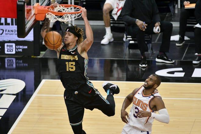 Memphis Grizzlies forward Brandon Clarke (15) dunks ahead of Phoenix Suns guard Chris Paul (3) in the first half Monday. [AP Photo/Brandon Dill]