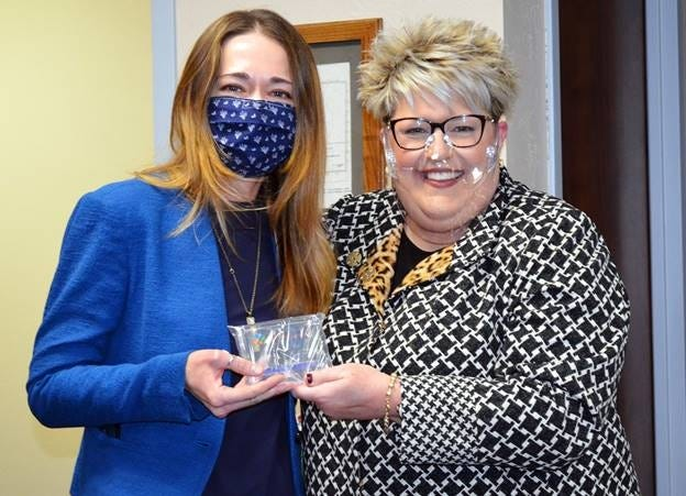 Lyuda Polyun, at left, receives a Director's Award from DRS Executive Director Melinda Fruendt. [PHOTO PROVIDED]