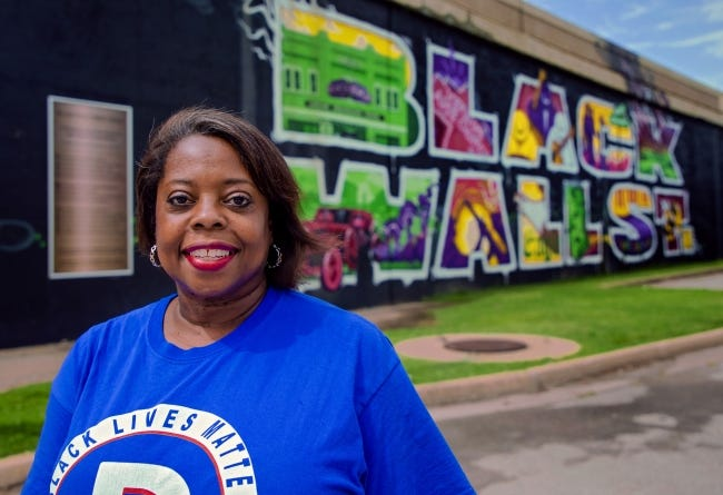 Alicia Andrews, Oklahoma Democratic Party chair, is shown in this file photo from August near the Black Wall Street mural on Greenwood Avenue in Tulsa. [Chris Landsberger/The Oklahoman]