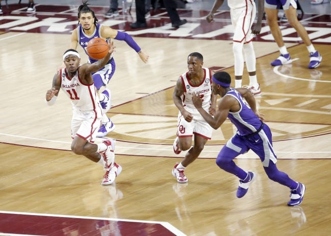 Oklahoma's De'Vion Harmon (11) gets a loose ball during a 76-50 win against Kansas State on Tuesday at Lloyd Noble Center in Norman. [Sarah Phipps/The Oklahoman]