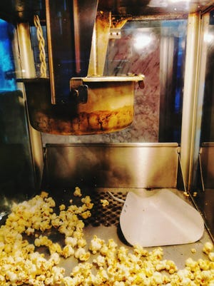 The golden-salty greatness that is movie theater popcorn can come to life at home and all it takes is a little dash of magic. [Dreamstime/TNS]