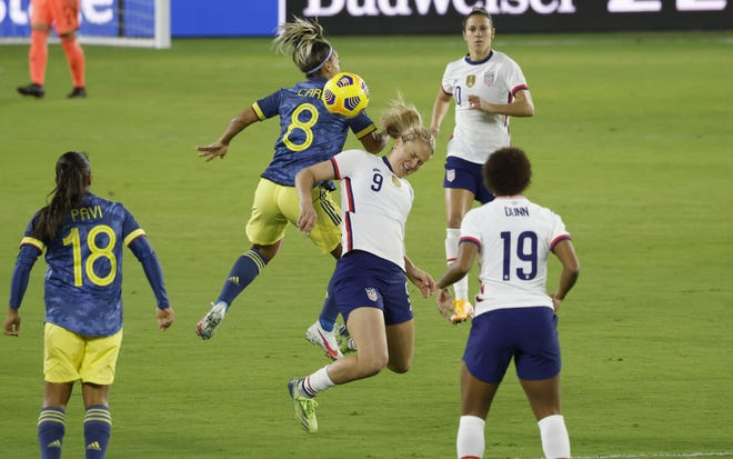United States midfielder Lindsey Horan (9) and Colombia midfielder Jessica Caro (8) battle for the ball as Carli Lloyd (10) and Crystal Dunn (19) close in with Colombia's Manuela Pavi (18) in the first half of the United States' 4-0 win Monday in Orlando, Fla. [Reinhold Matay/USA TODAY Sports]