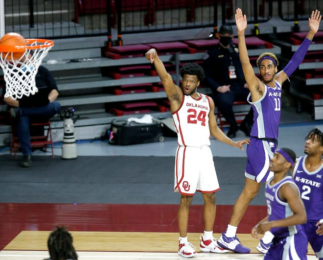 Oklahoma's Elijah Harkless (24) watches his 3-point basket go in next to Kansas State's Antonio Gordon (11) during the second half of the college basketball game between the Oklahoma Sooners and the Kansas State Wildcats at Lloyd Noble Center in Norman, Okla., Tuesday, Jan. 19, 2021. OU won 76-50. Photo by Sarah Phipps, The Oklahoman